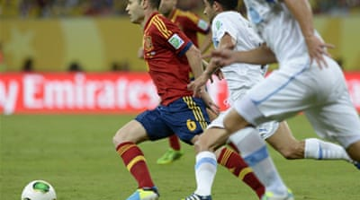 Spain beat the South American champions Uruguay 2-1 in Sunday's clash [AFP]