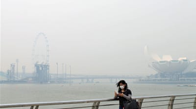 Singapore's famous skyline is barely visible through the midday haze [Heather Tan/Al Jazeera]