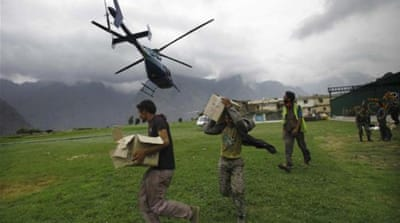 Indian soldiers assist pilgrims coming down from the Himalayan mountains deluged by flood waters [AFP]