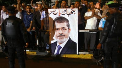 Egyptians gather in support of President Mohammed Morsi during a pro-government rally in Cairo [EPA]