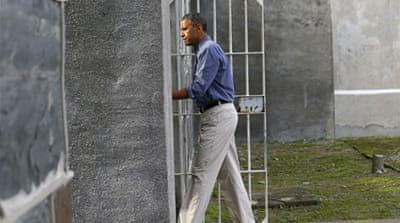 Obama visits Mandela prison in Cape Town