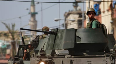 Lebanese soldiers patrol the Sunni Muslim Bab al-Tebbaneh neighbourhood following sectarian clashes [Reuters]