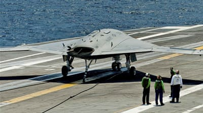 An X-47B makes its return journey [Reuters]