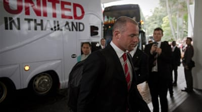 Rooney, right, attended training with Patrice Evra and their United teammates in Bangkok but didn't play [Getty Images]