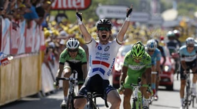 Cavendish celebrates on the podium after winning the 173km 13th stage of the Tour de France  [AFP]