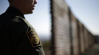 The Senate's immigration bill calls for adding 1,100 additional kilometres to the US-Mexico border wall [AP]