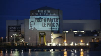 One of the visuals unveiled by the activists read 'Tricastin, nuclear accident, ready to pay the price?' [AFP]