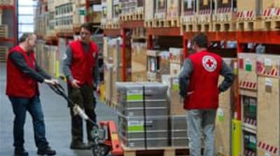 The Red Cross helps thousands of people in areas encircled by government and opposition forces [Al Jazeera]
