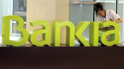 Spain's 4th largest bank, Bankia, was heavily exposed to the collapse of the Spanish property sector [EPA]