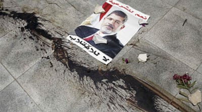 The blood of Morsi supporters stains the pavement where they were killed in Nasr City during clashes [Reuters]