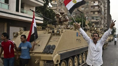Anti-Morsi protestors celebrate overthrown of the president on the streets [AFP]