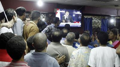 Moments after the military announced it had taken control, 'pro-Morsi' TV stations were shut down [Reuters]