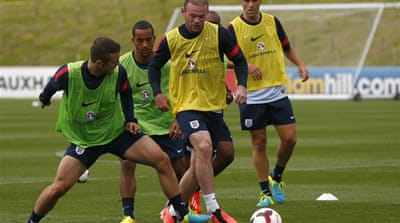 Rooney, right, seemed fit enough as he trained with England team-mates including James Milner  [Reuters]