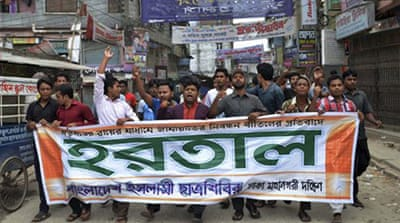 Activists of the Jamaat-e-Islami party shouted slogans as they marched during a strike in Dhaka [File/AP]