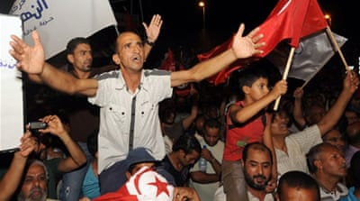 Many Tunisians have been calling for a technocratic government following a political assassination in July [Reuters]