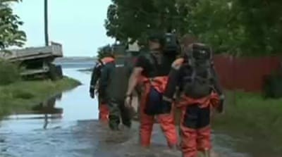 Thousands evacuated as floods hit Russia