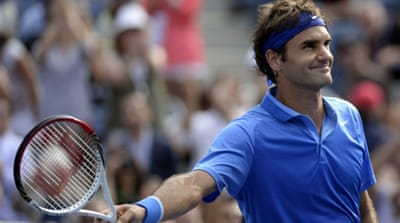 Federer faces a potential quarter-final match-up against old rival Nadal [AFP]