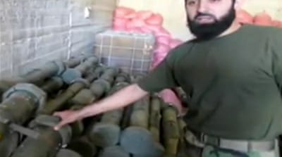 Syrian rebels seize army weapons cache