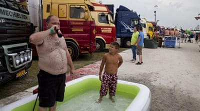 The heat caused many people in Germany to visit the coast or lakes, including Woerth Lake [AFP]