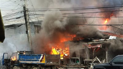 Houses were engulfed in fire after the attack in the centre of Cotabato [Reuters]
