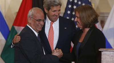 Kerry, centre, has said he does not expect an announcement after the planned round of talks [AP]