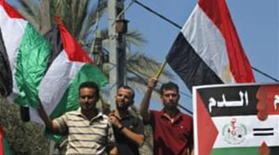 Hamas, the rulers of the Gaza Strip, denounced the 'bloody coup' in neighbouring Egypt [AP]