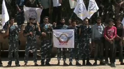 Rebel groups unite in Syria's Aleppo