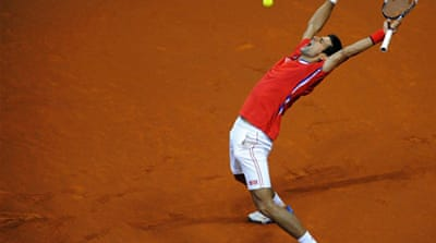 Janko Tipsarevic led Serbia into their second final in four years after defeating Vasek Pospisil [EPA]