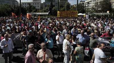 Greek state workers rally against job cuts