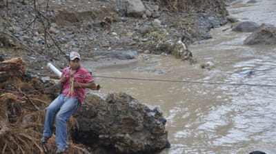 A collapsed bridge in Guerrero state after heavy rains and landslides hit the region [EPA]