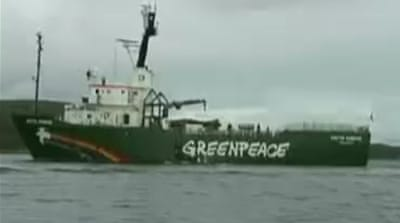 Greenpeace says activists held by Russia
