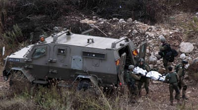 The Israeli military transported the body of the slain soldier from the West Bank [Reuters]