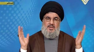 Nasrallah urged supporters of Syrian rebel forces to 'review their positions' and back a political settlement [AFP]