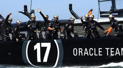 Oracle Team USA reacts after crossing the finish line to win Race 17 and tie series 8-8 [EPA]
