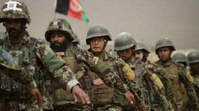 A Taliban spokesman said its forces were battling Afghan troops 'from all sides' [AFP]