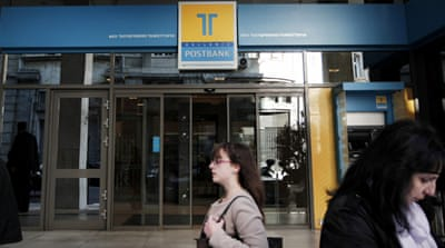 At least 25 people have been charged in an investigation into loans issued by Hellenic Postbank [EPA]