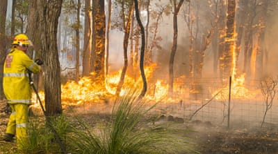 Nearly 150 firefighters continued to fight the blaze in Perth that took one man's life and destroyed 27 homes [AP]
