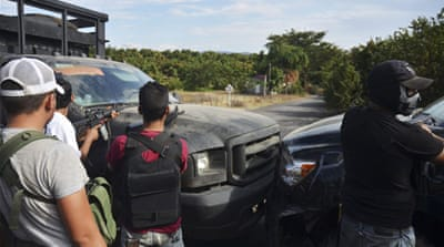 Mexico forces face off with vigilantes