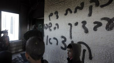 "Attackers sprayed ""Arabs out"" and ""Revenge for blood spilled in Qusra"" on the mosque's wall [AFP]"