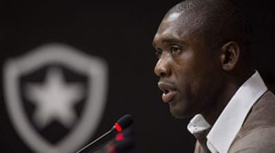 Clarence Seedorf smiles upon his arrival at Milan where he replaces Massimiliano Allegri [AFP]