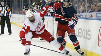 Todd Bertuzzi of the Detroit Red Wings holds back Ryan McDonagh of the New York Rangers [AFP]
