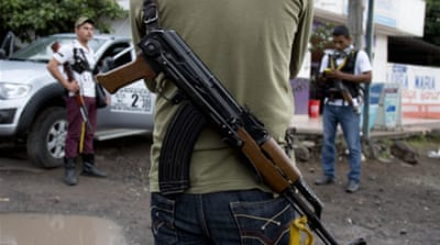 Mexico asks vigilantes to surrender weapons