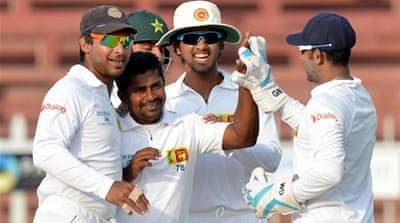 Sri Lankan bowler Rangana Herath celebrates after dismissing Ahmed Shehzad [AFP]