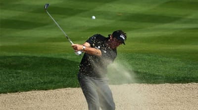 Phil Mickelson of the US plays out of a bunker at the Abu Dhabi HSBC Golf Championship [AFP]