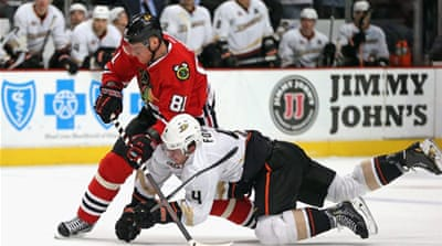 Cam Fowler of the Ducks tries to take down Marian Hossa of the Blackhawks [AFP]