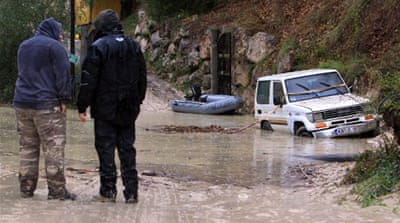 More than 1,000 people have been cut off as landslides block roads in Italy and France [AFP]