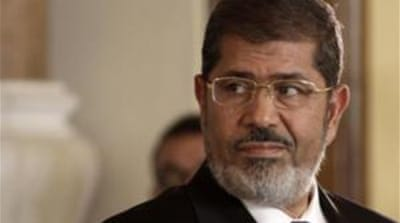 "A civil complaint filed against Morsi alleges he spent too much public money on ""ducks and grilled meat"" [EPA]"