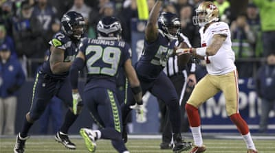 Seattle's Malcolm Smith intercepted a pass intended for Michael Crabtree in the end zone [Reuters]
