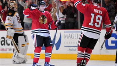 Patrick Kane (88) is congratulated for scoring the game-winning goal against Boston Bruins [Reuters]