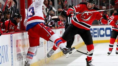 Eric Gelinas and Jay Beagle collide in the New Jersey Devils vs Washington Capitals match [AFP]